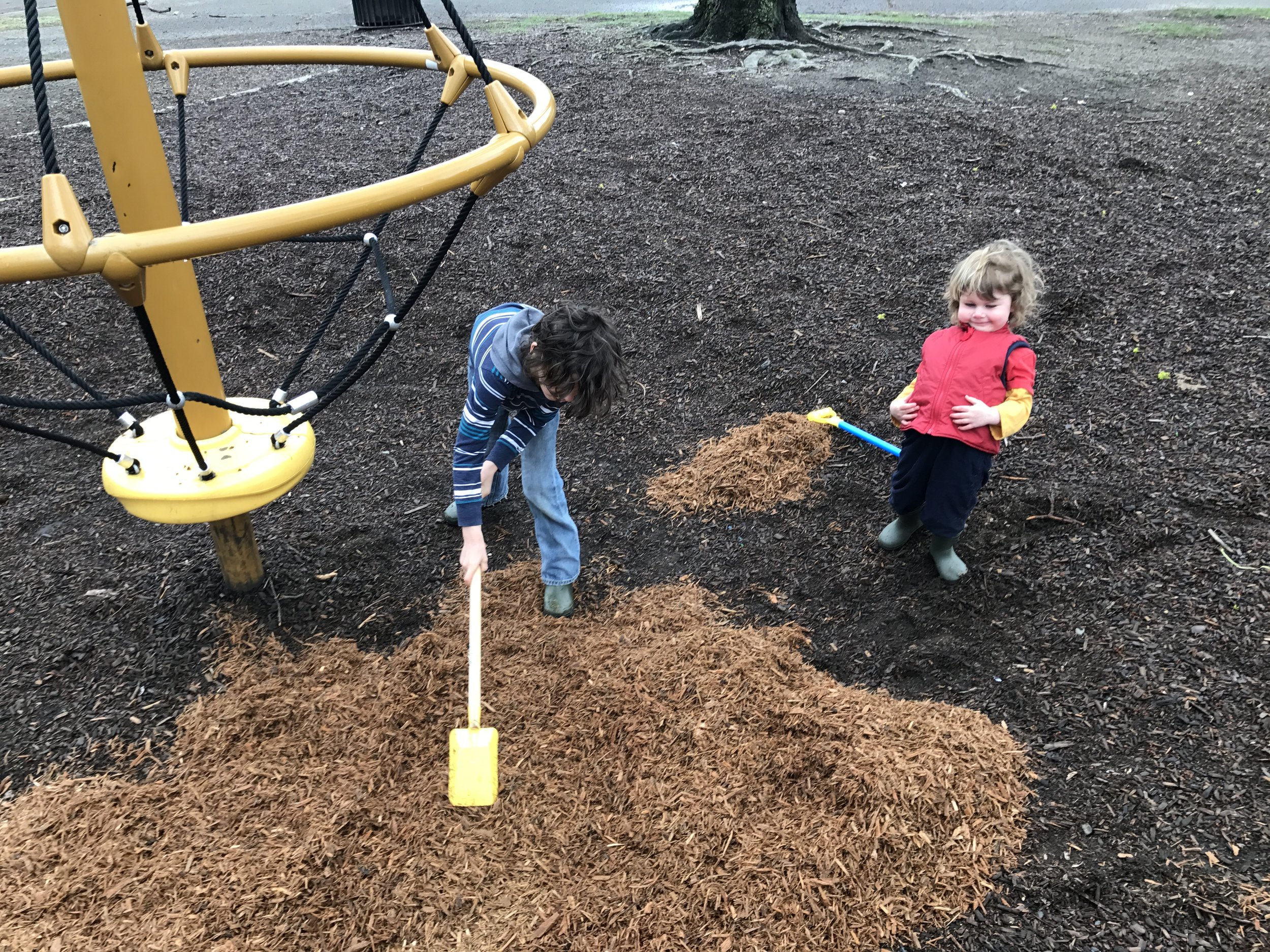 It takes many small hands to spread new playground mulch Photo credit: Caleb Borchers