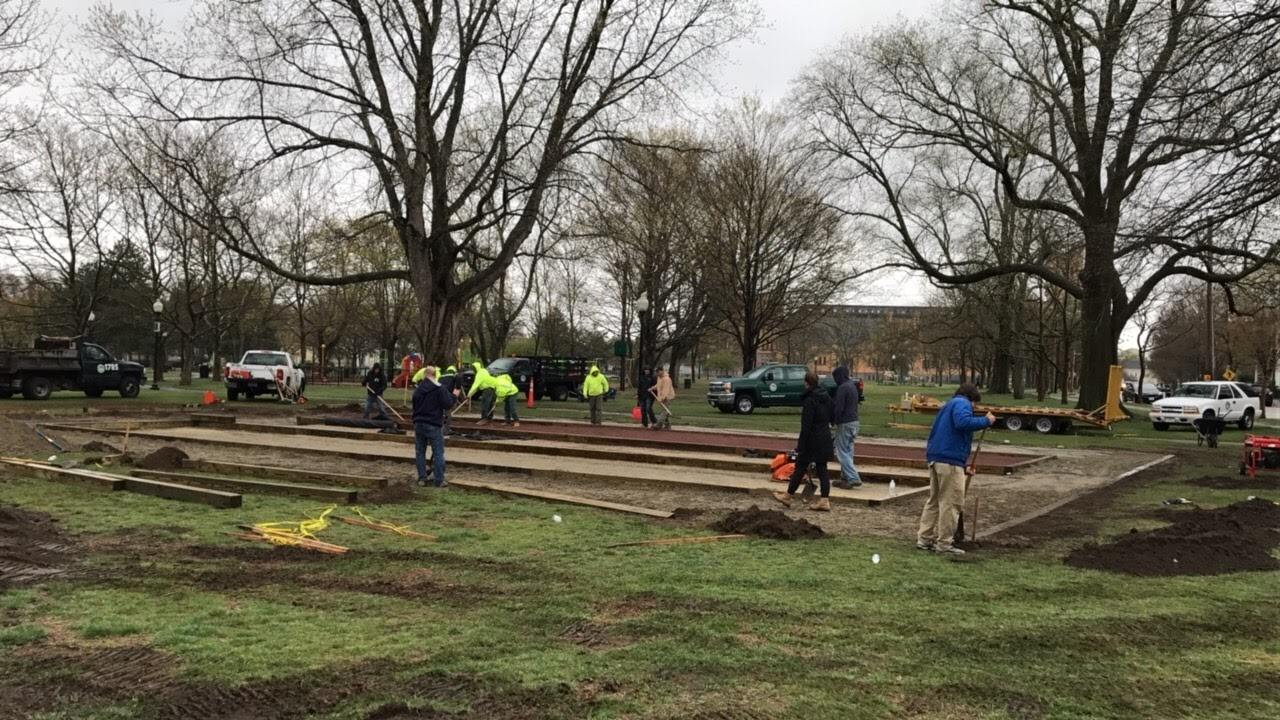 Parks Department works for a few days after the volunteer build to complete the courts