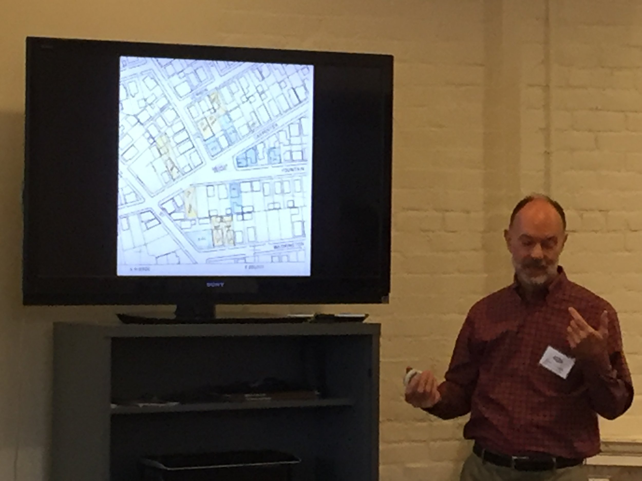 Clark Schoettle of Providence Revolving Fund gives a slideshow about PRF's transformation of many of the abandoned homes in the Luongo Square area, all of which became affordable housing units. Photo by Kari Lang