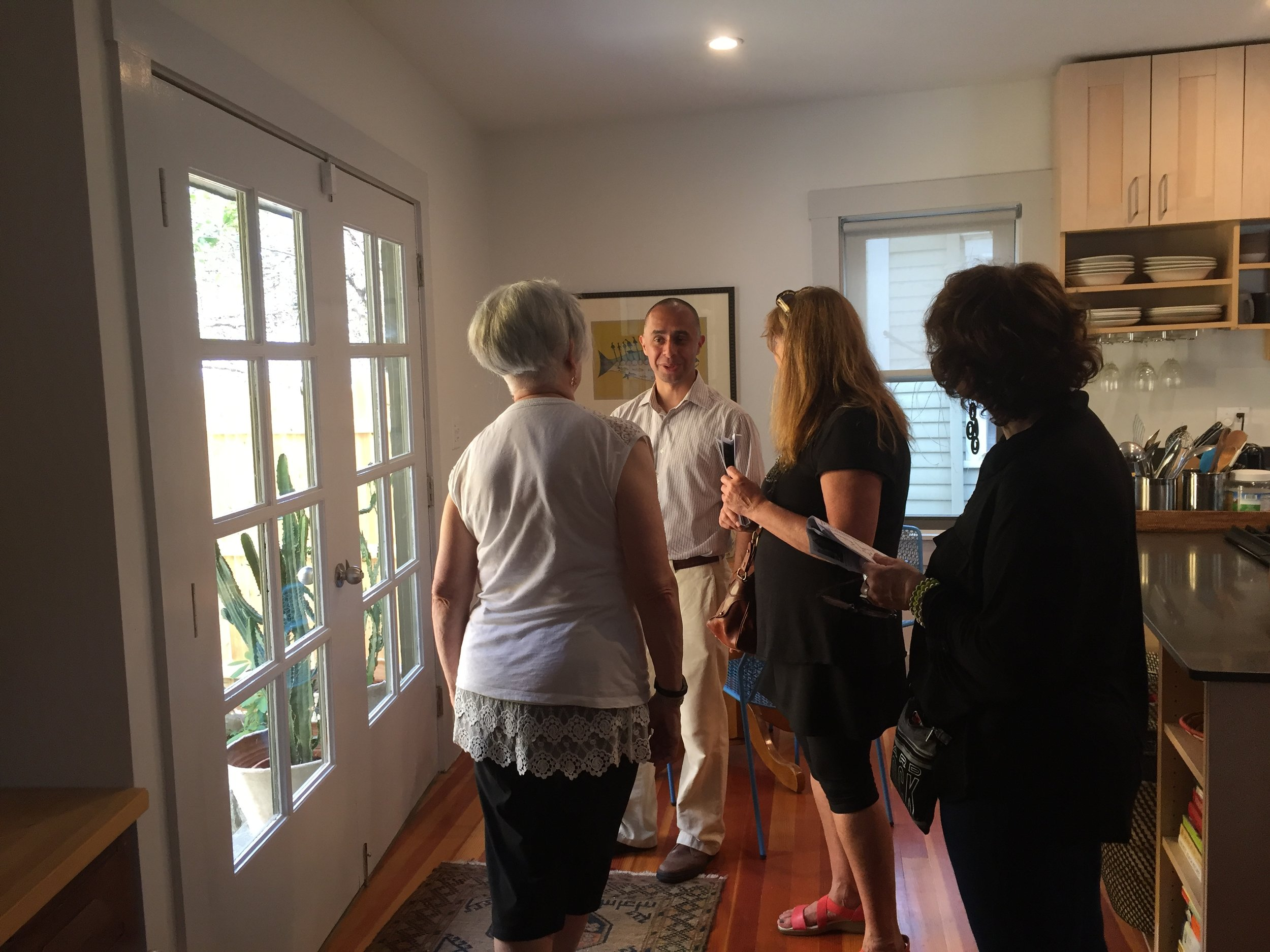 """Mayor Jorge Elorza visits his former residence on Carpenter Street,and tells stories about this part of the neighborhood from """"back-in-the-day."""" Photo by Kari Lang"""