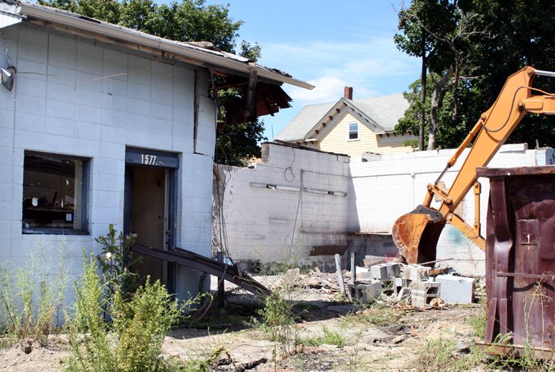 Demolition of the former auto repair shop