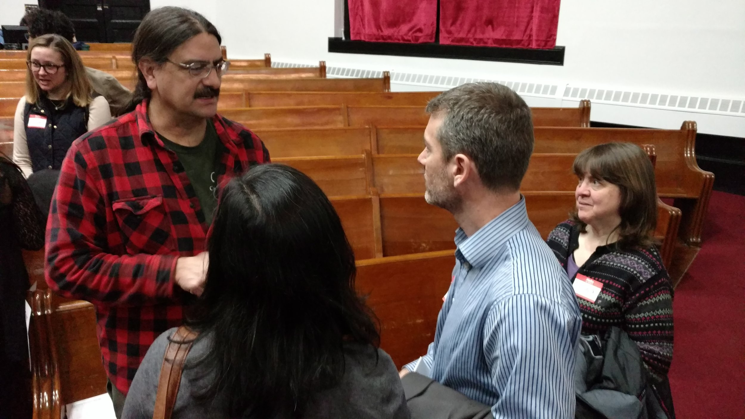 Neighbors and board members meet and mingle after the program