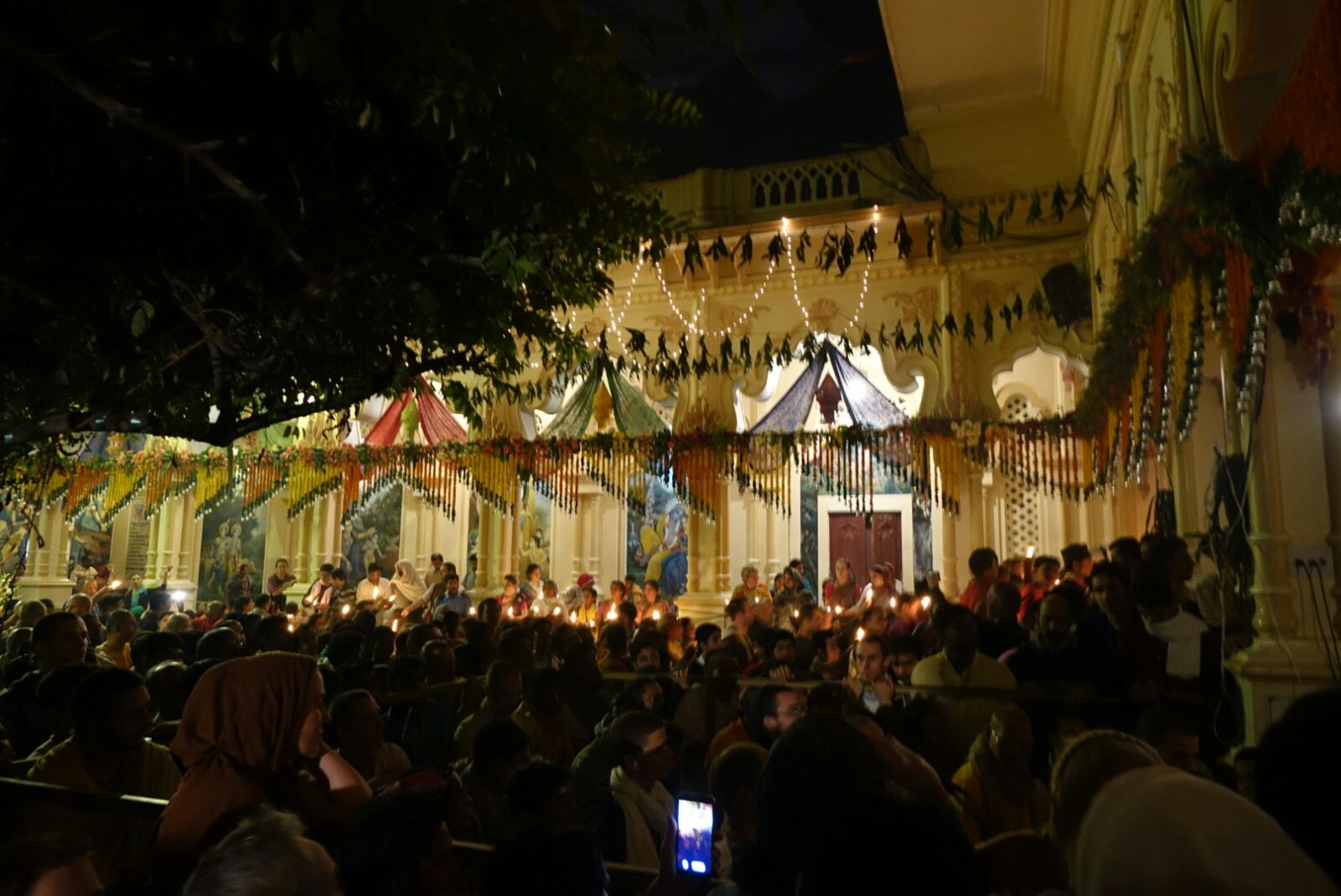 Thousands of people offering lamps in a temple in Vrindavan