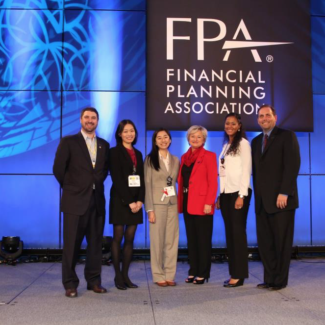 Compass Financial Coaching Associate Phuong Luong (third from left) with FPA President Janet Stanzak (third from right), FPA leadership, and fellow Diversity Scholars.