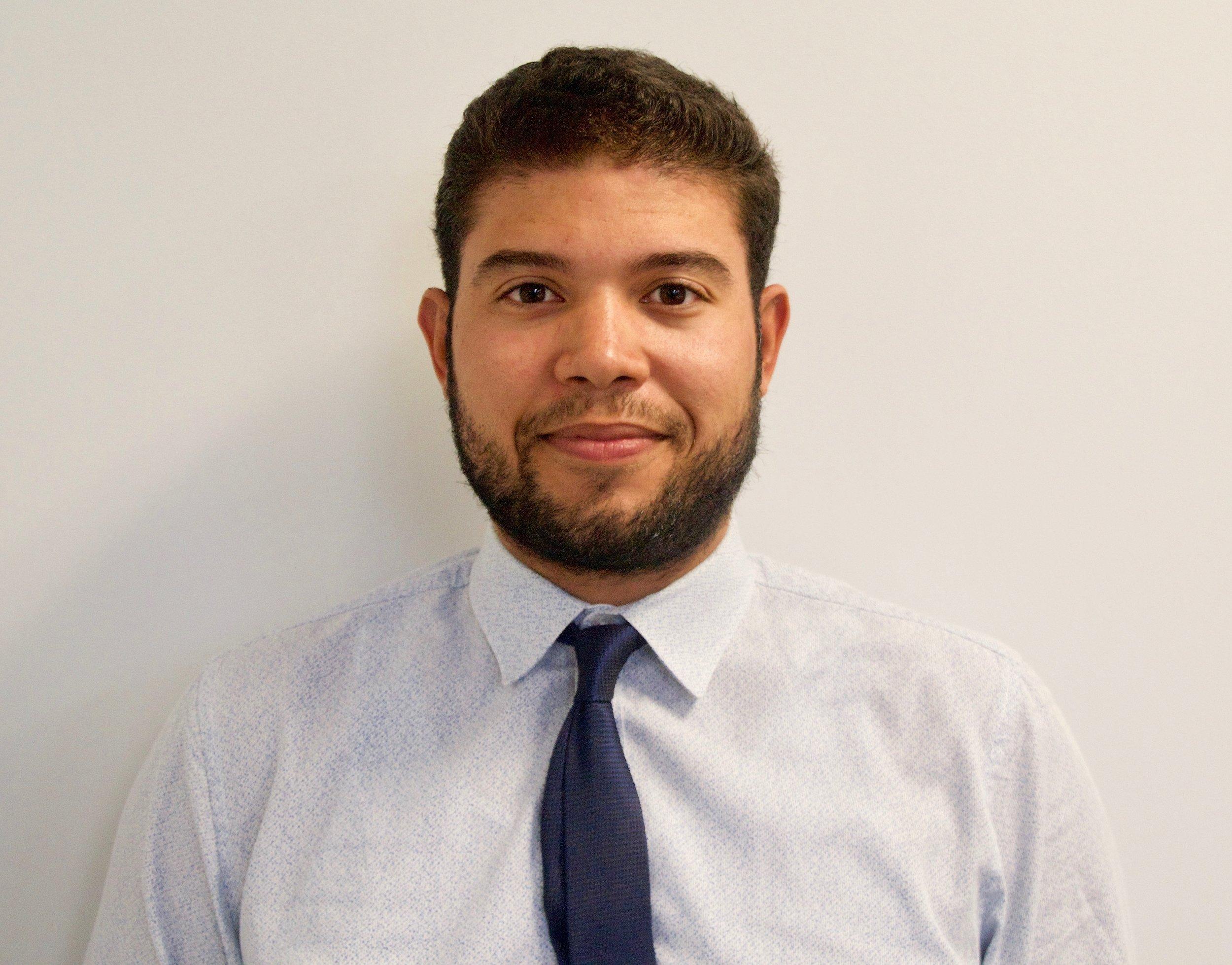 Jason Andrade,  Director of Financial Coaching