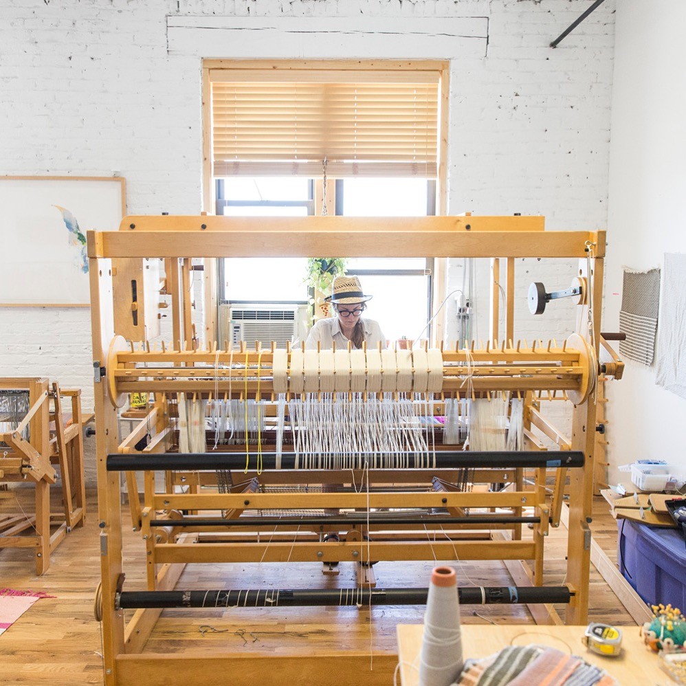 Working at Studio Herron in Chicago on Big Helen the AVL Dobby Loom. Photo Credit: Mike Killion for Saturate Chicago.