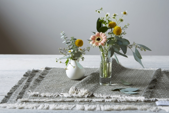 Photo by Jennifer Marx. From the cut remnants of blankets, table linens and pillows are made. These are the new placemats which can be purchased  here .