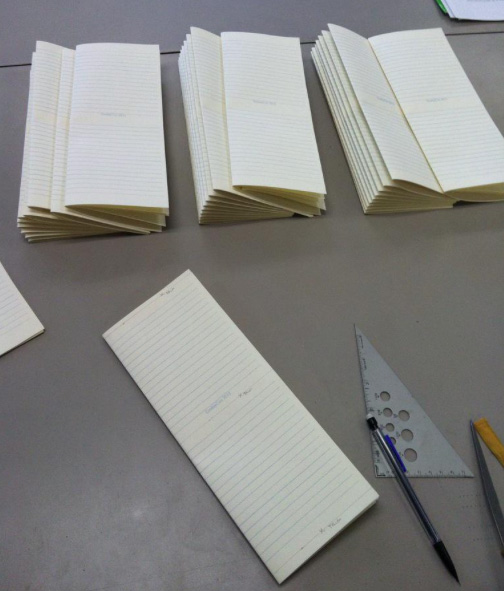 My custom pages in the hands of mage binder Dave Rollins of Black Magic Bindery. Photo courtesy of Black Magic Bindery.