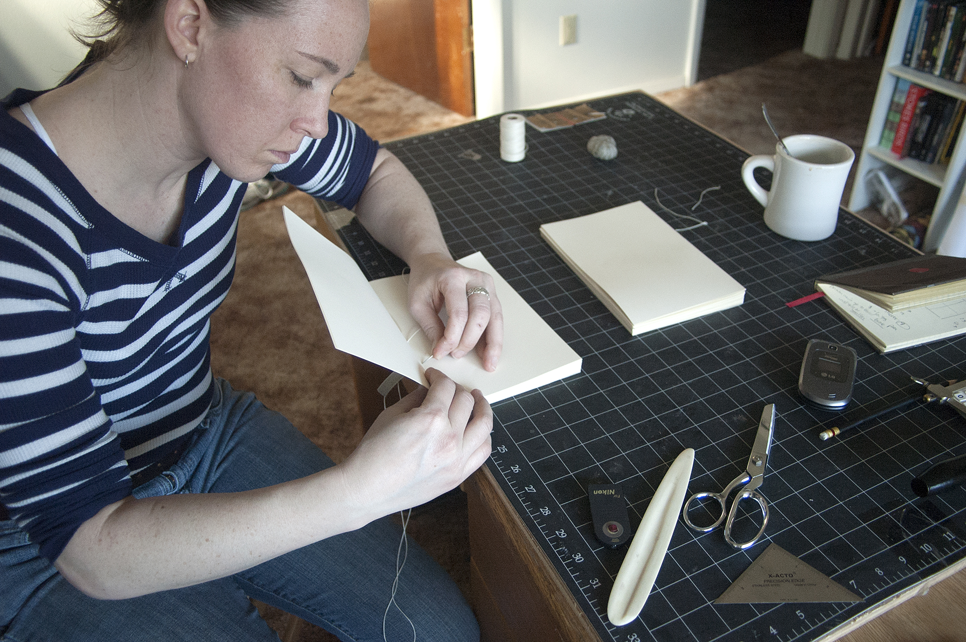 All of my books are bound entirely by hand, sewn together one page at a time.