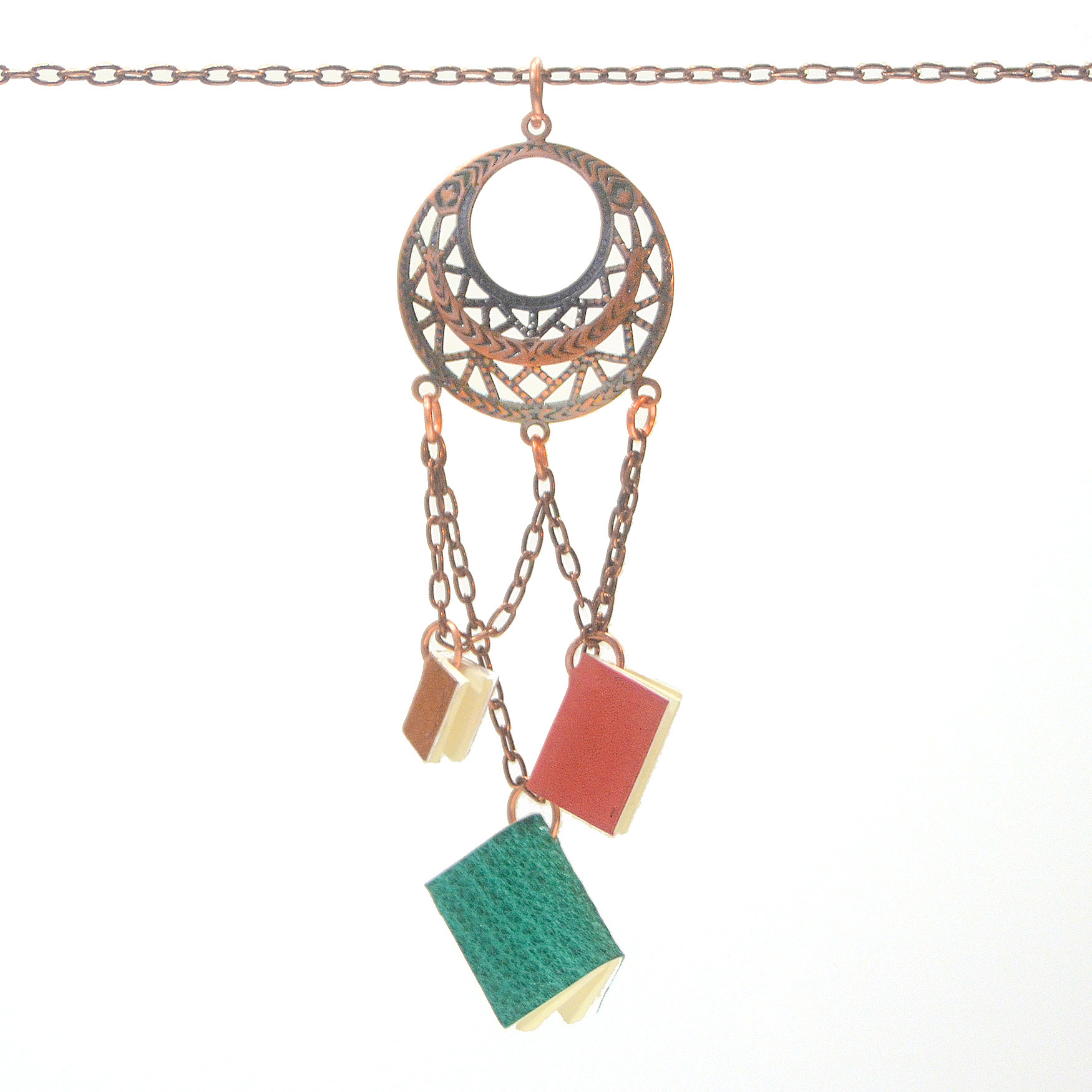 This chained-book pendant is inspired by an ancient practice of chaining rare and invaluable books to lecterns and bookshelves. These tiny books are fully functional and can be inscribed, becoming a personal, portable chained library.