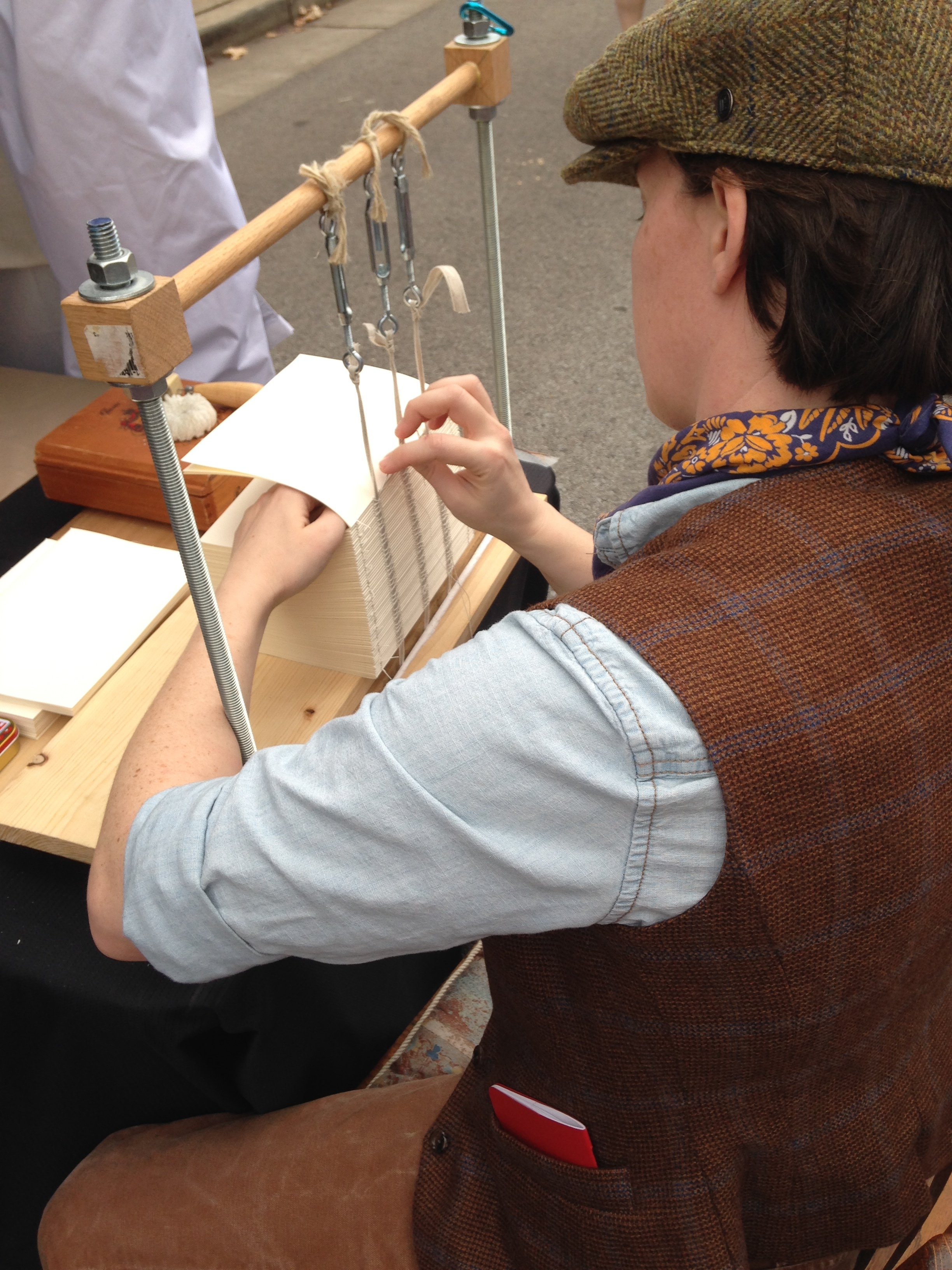 Me demonstrating the traditional method of sewing books on a frame as a Victorian era demonstrator for last winter's Dickens of a Christmas festival in Franklin, TN.