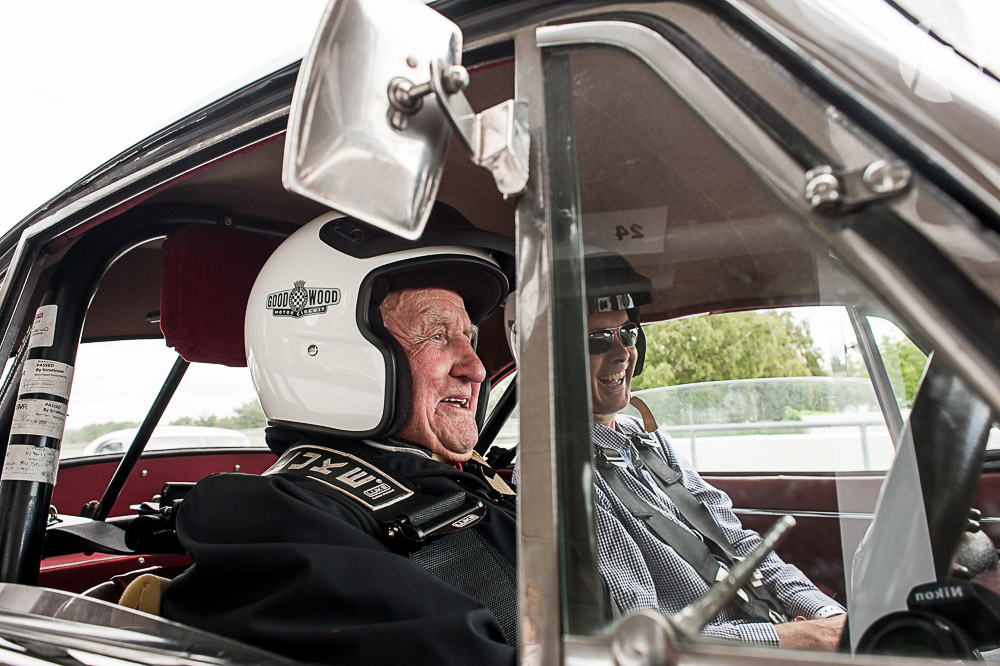 Norman Dewis OBE at the wheel with Kevin in the XK150