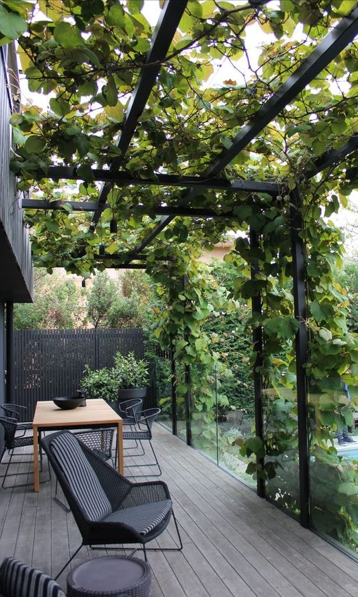 Pergola - Pergolas serve as ideal structures for creating a shaded walkway or seating area in the garden. Made of sturdy pillars topped by cross-beams and an open lattice, pergolas make a statement whether alone or supporting woody vines. Climbers such as grapes, roses, and wisteria look particularly pleasing when trained along a pergola and provide much-needed shade in the summer.