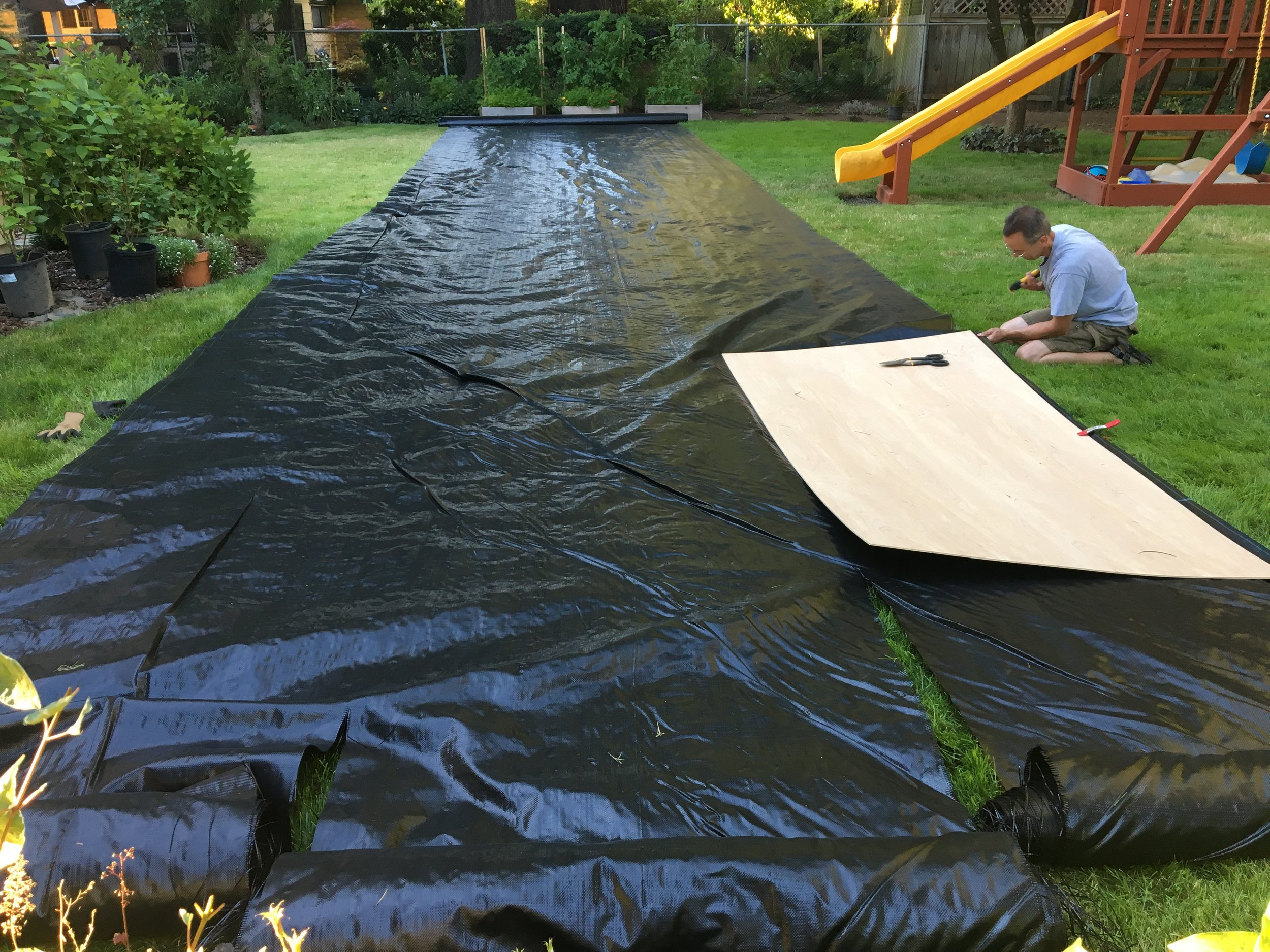 Dave measuring & cutting geotextile fabric