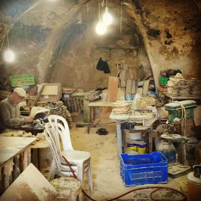 A quick look inside a workshop in Bethlehem reveals men at work, carving olive wood into miniature mangers and other icons #bethlehem #olivewood #anthropology #visualanthropology #ethnography #skilledtrades #craftsmen #lathe #culture #culturerealm #palestine
