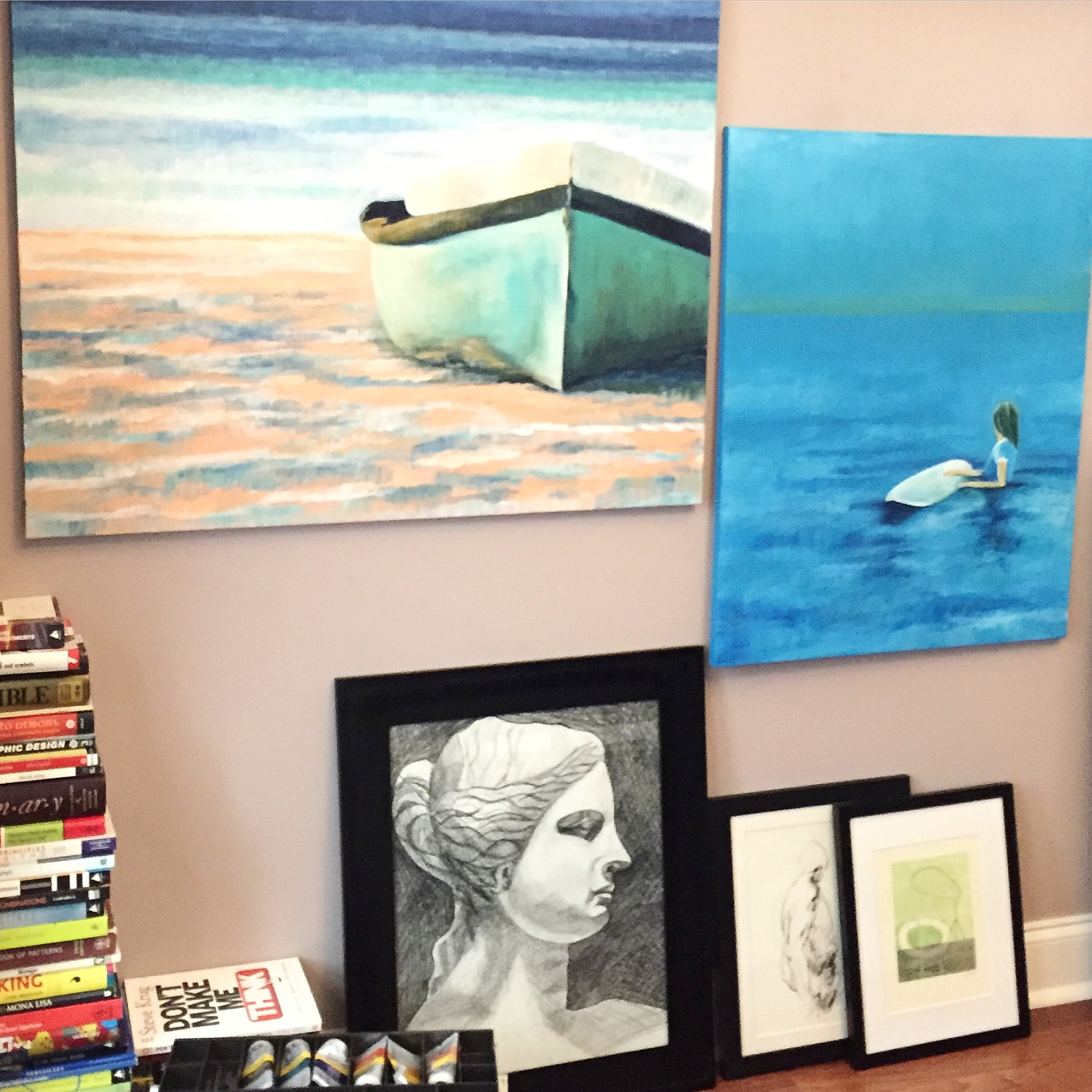 """Shot of my office before I began hanging some pieces that I recently purchased. The two wall pieces are mine and the lady on the floor. Small pieces on ground: left: """"Drawing 120""""  Derek Overfield,  right: """"Original Monotype""""  Jenny Gray"""