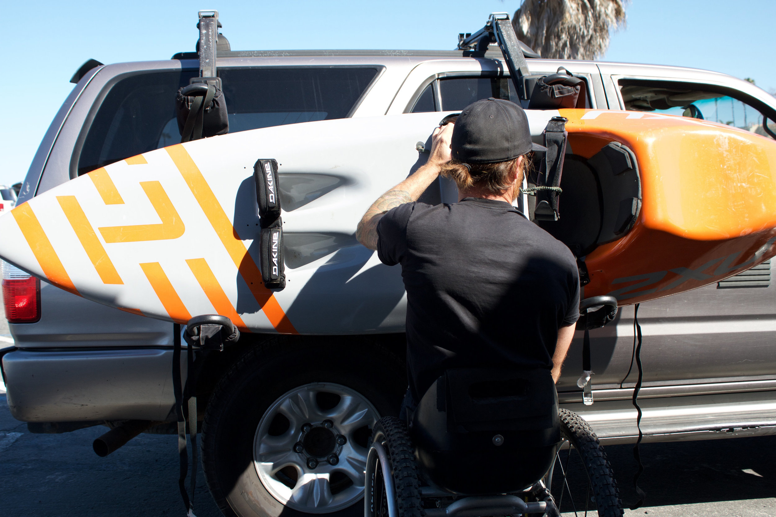 Getting the board off the car. Thanks to Thule for the racks! Photo by Austin Novy