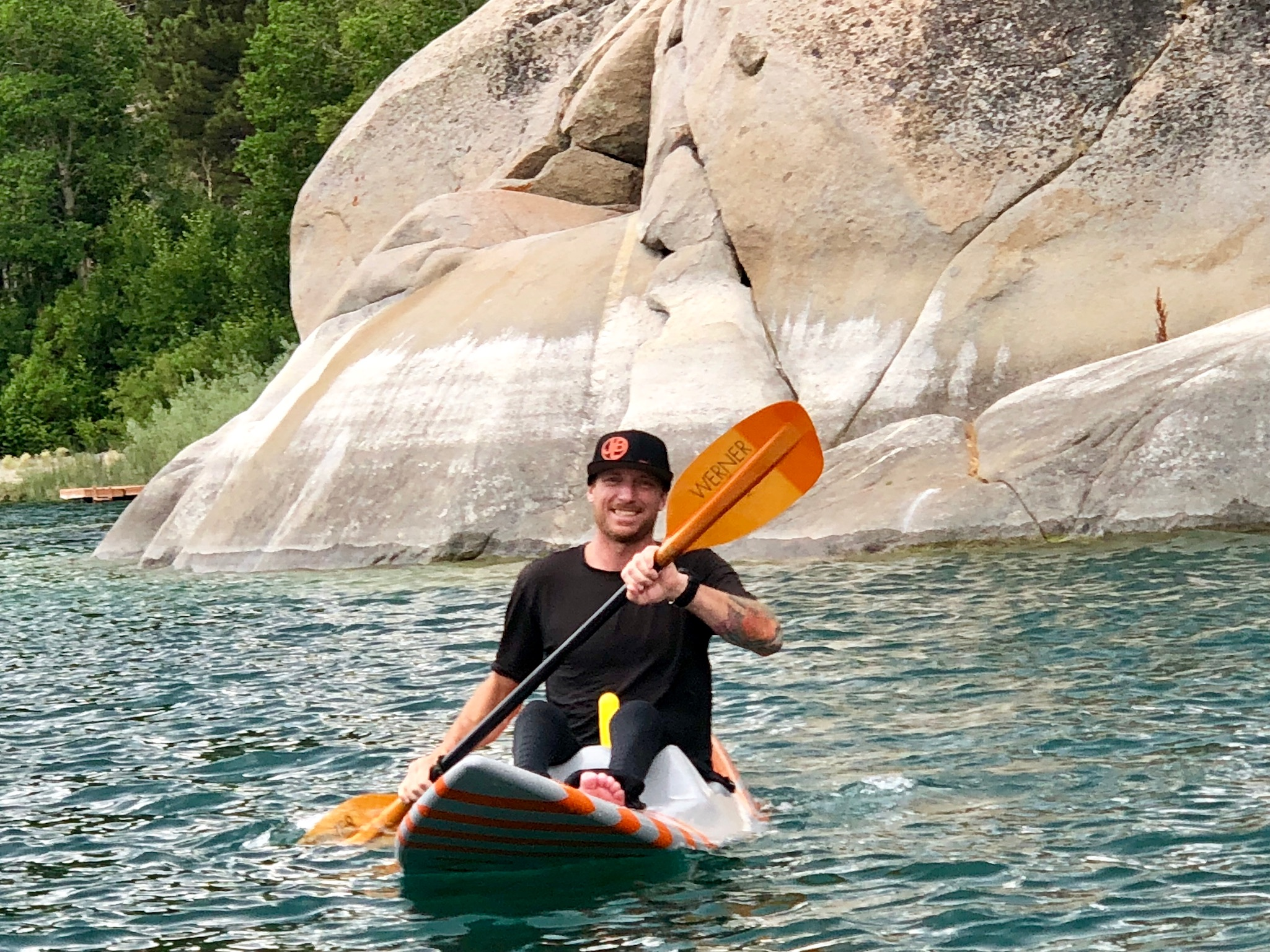 Surfboard doubles as a kayak. Don't pay attention to how I'm holding the camera with the yellow bobber handle