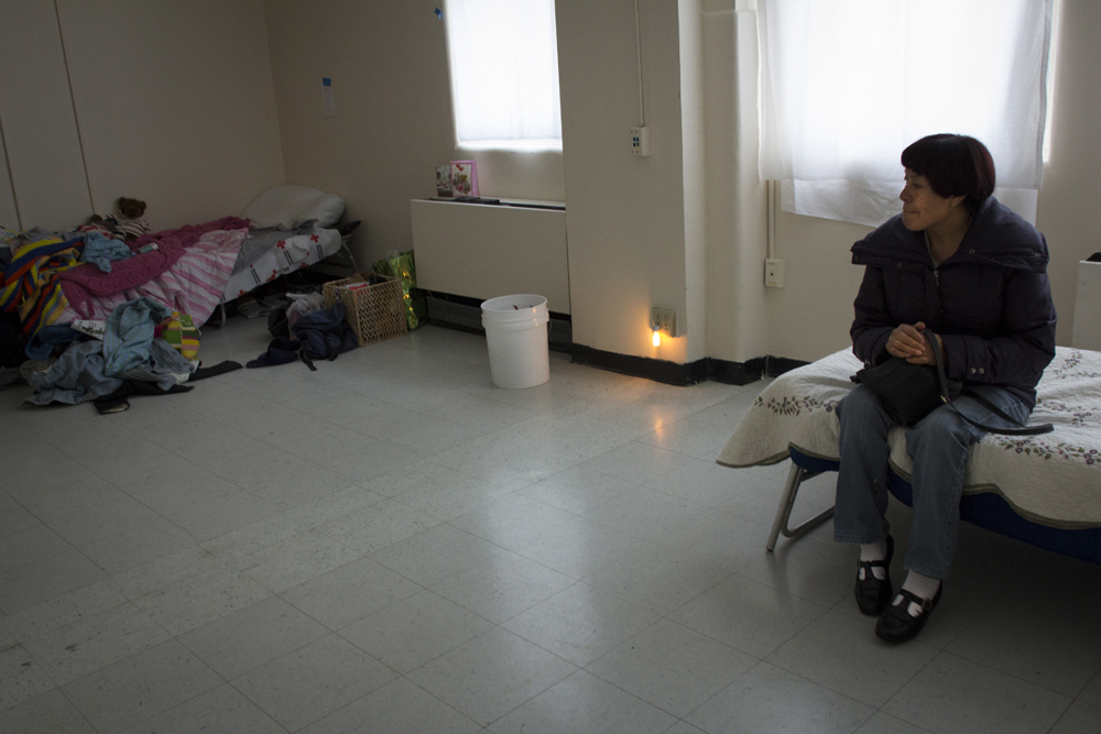 Felipa Campos, 51, sits in her assigned room at the shelter run by Project Hospitality in Staten Island. Campos, an undocumented immigrant from Mexico, has been homeless since the storm destroyed her home in Midland Beach, Staten Island.