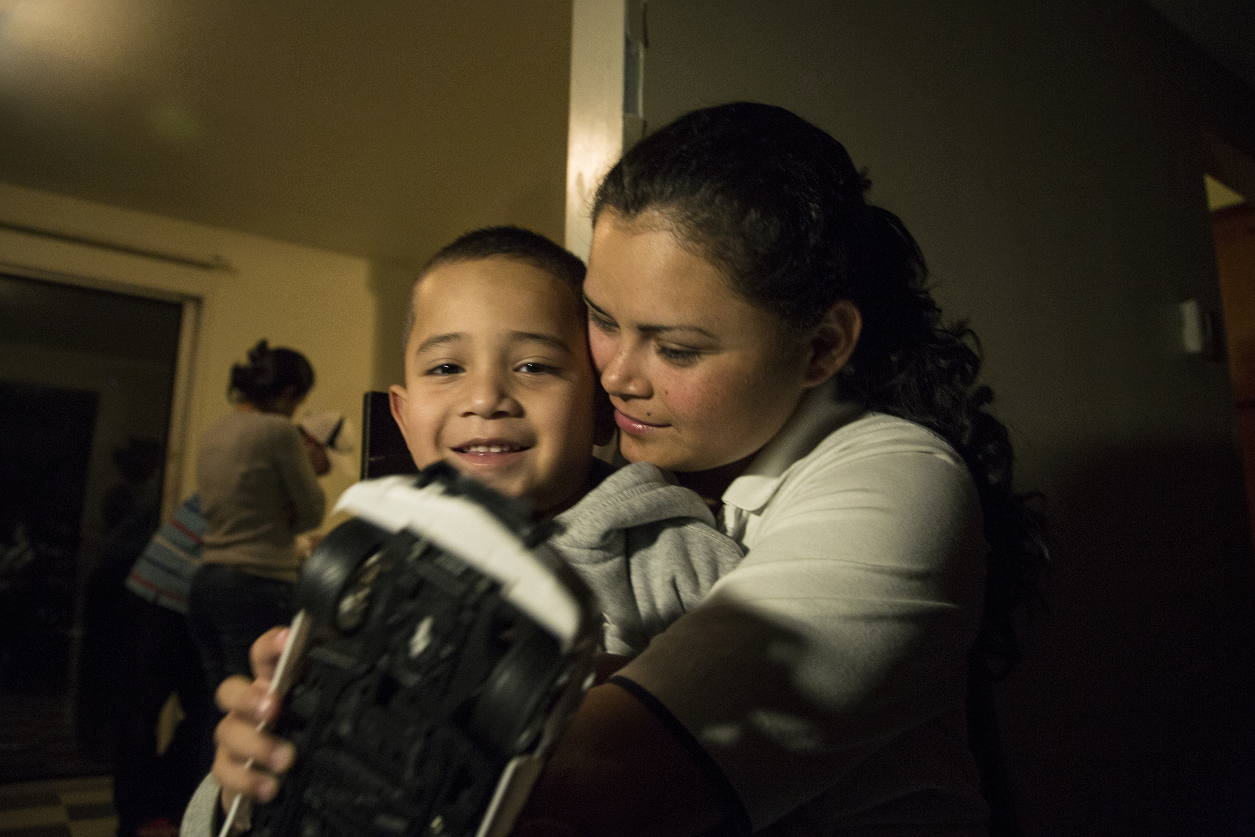 Cristel holds her son, Christopher (4) two nights before she leaves Eugene to represent them in court. The two traveled from Honduras in the summer of 2014 and crossed the U.S. border to reunite with family members in Oregon. Without legal representation, it is likely they will be deported.