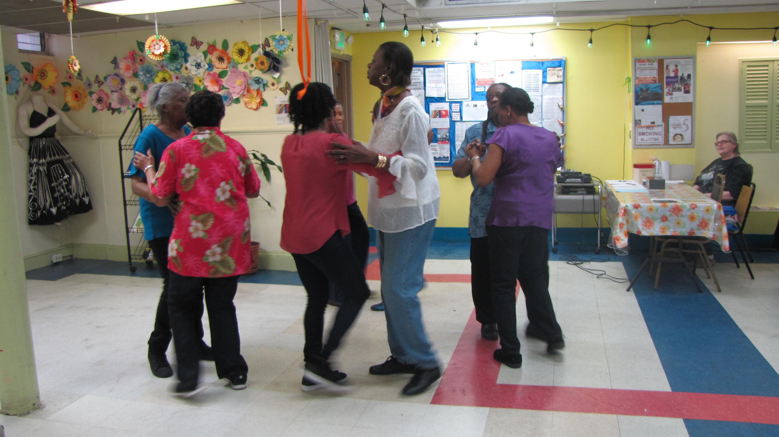 Members of the Remsen Neighborhood Senior Center demonstrate Cuban rueda de casino at the Dorchester Senior Citizen's Center.