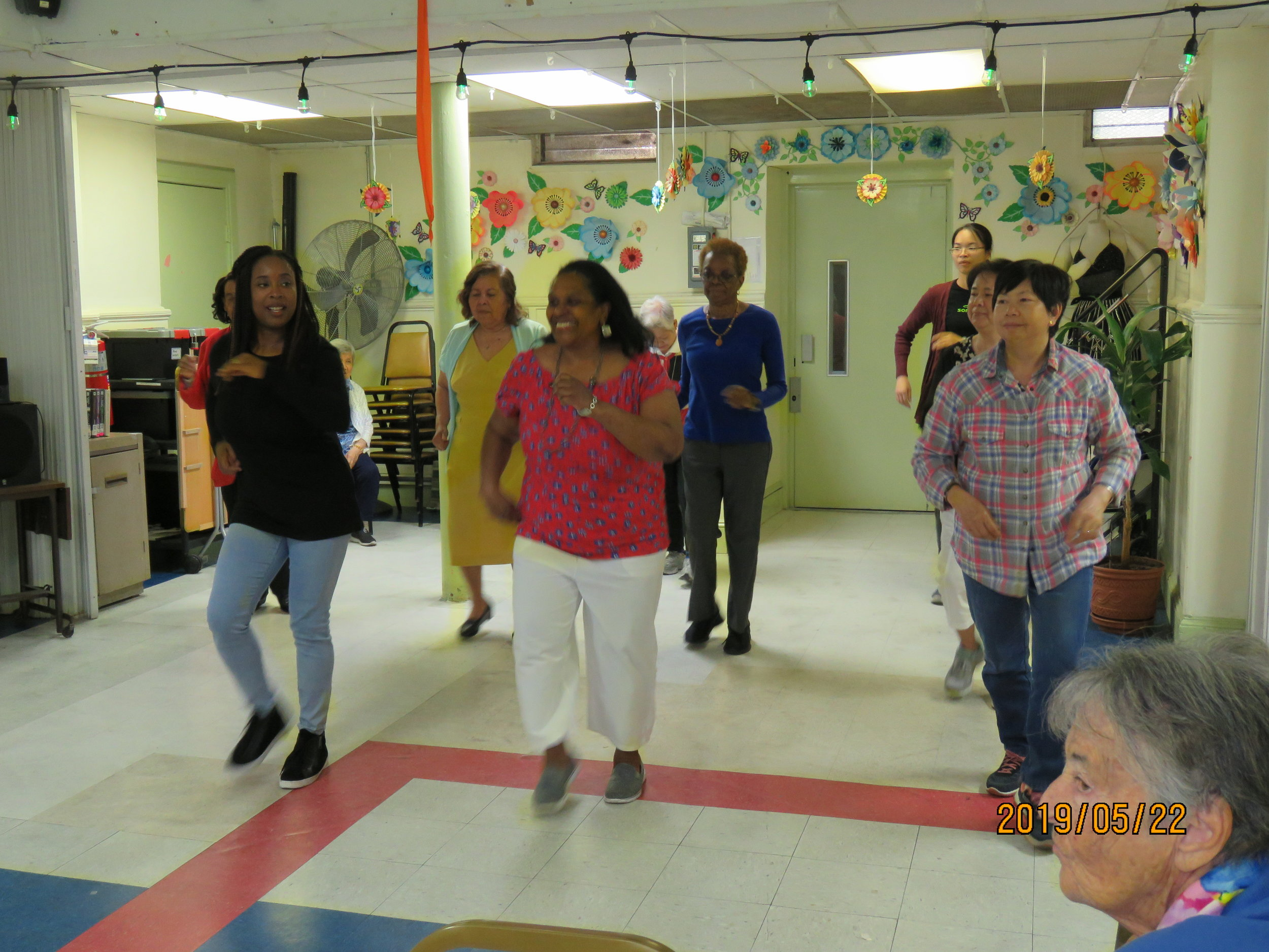 "Seniors dancing to Maite Hontelé's ""Gracias te doy"" during the program's culminating performance."
