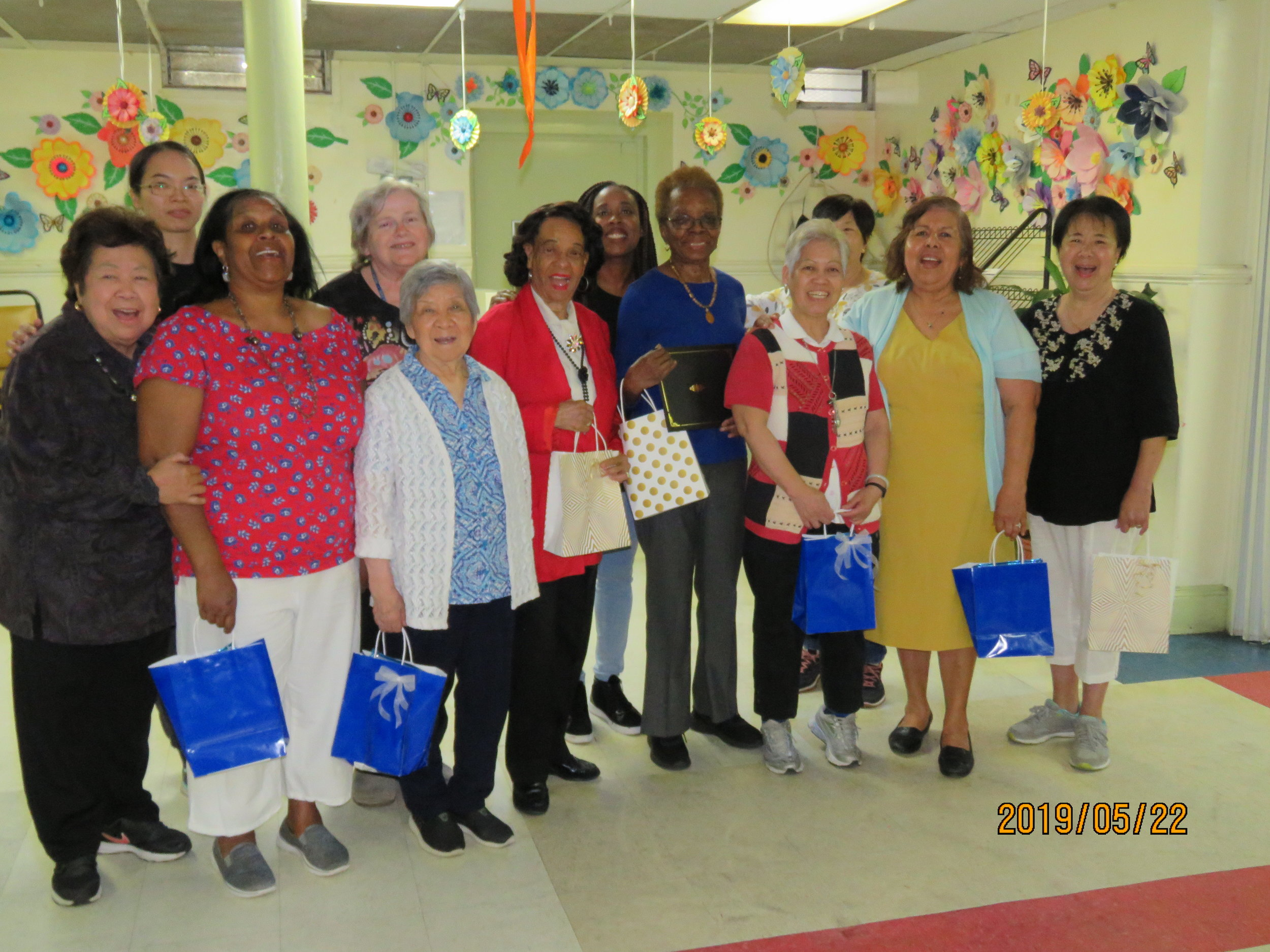 Seniors participating in the Cuban Song & Dance residency at the Dorchester Senior Citizens Center pose for a picture with instructor and SU-CASA artist, Danielle Brown after performing during the culminating event for the residency. SU-CASA is funded in FY19 by New York City Council, and we thank Councilmember Mathieu Eugene for his support.