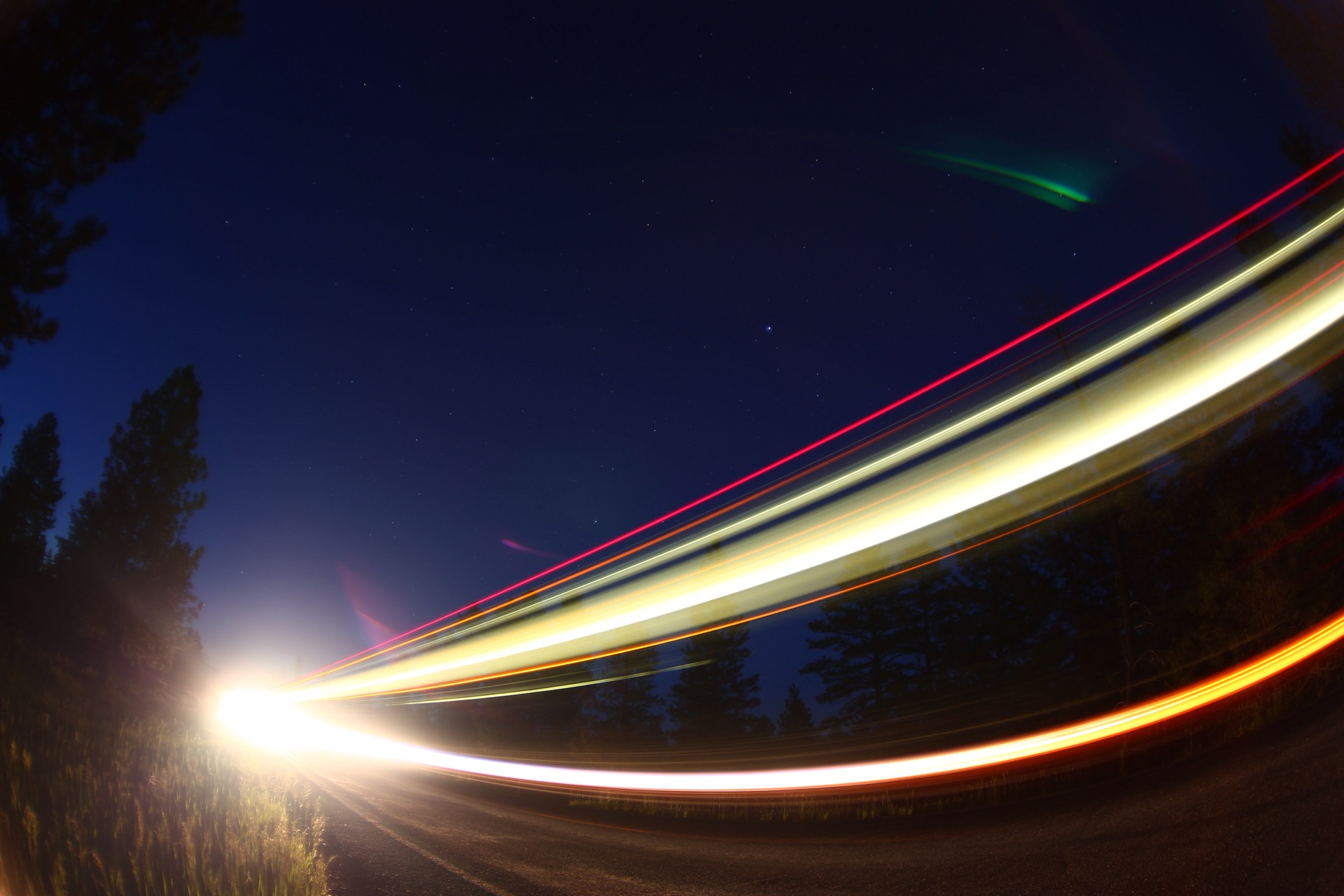 Long exposure shot of some passing cars at night
