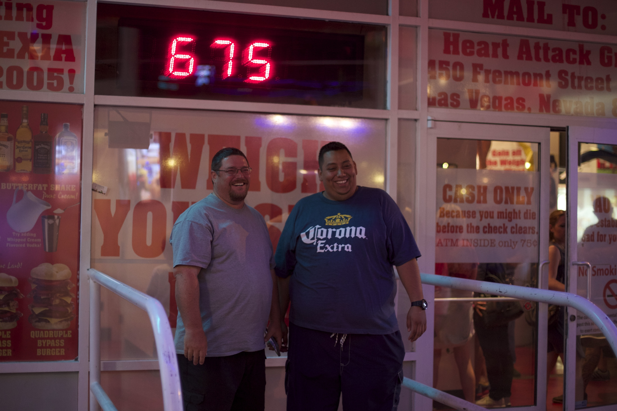 some big dudes weighing in outside of Heart Attack Grill. If you weigh over 350 pounds, you get free food.