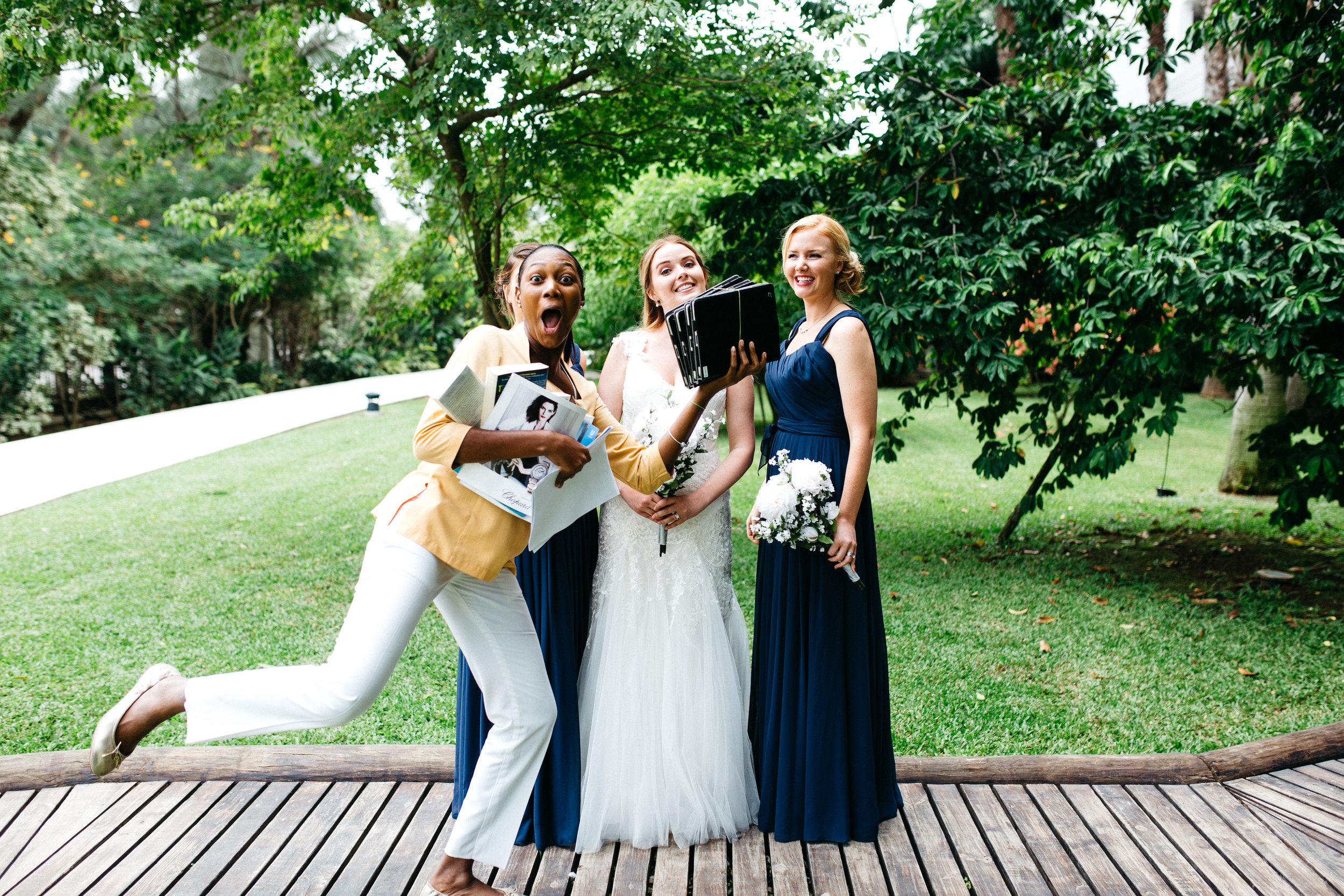 Photobombs happen. This might be the best one yet. She's the resort's wedding planner, and she completely rocked.