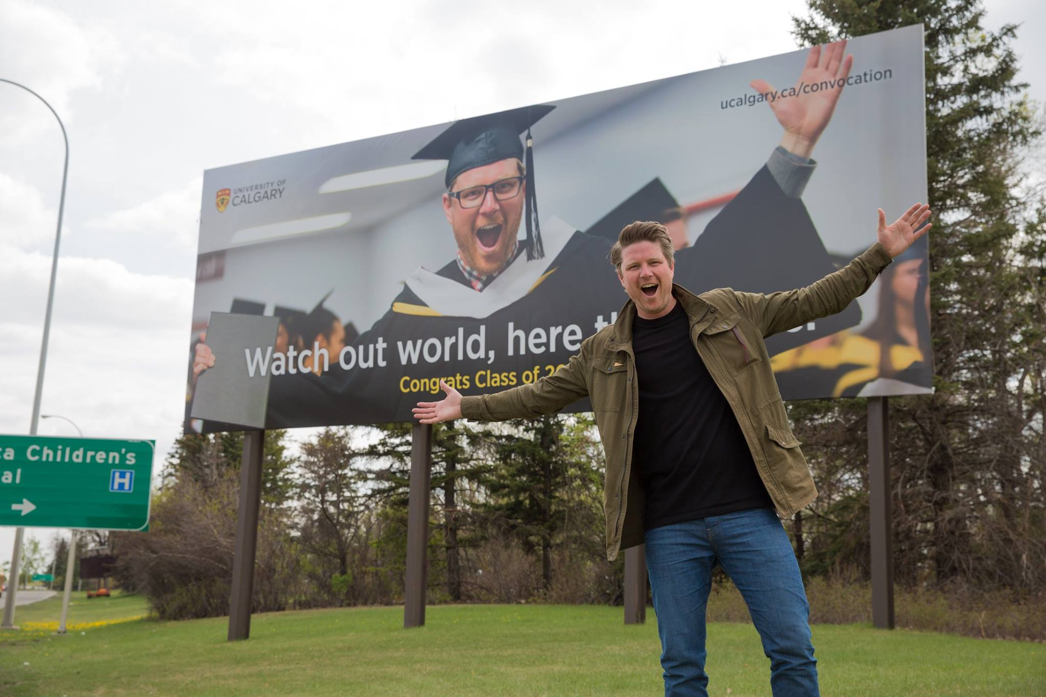 Standing in front of a massive billboard I was featured on to promote 2015 spring convocation at the University of Calgary.