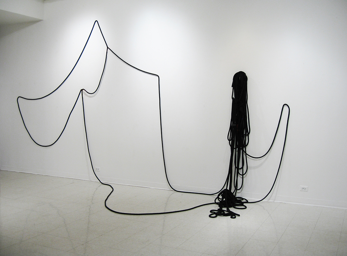 Hanging Drawing (Half-Drawn) , 2008, rope and wood shelf, dimensions variable approx. 15' x 30' x 8'  The  Hanging Drawing  series is an ongoing exploration of physical and collaborative approaches to drawing. This work is shown installed at Montserrat College of Art, Beverly, MA. This particular drawing was made by the curator of the exhibition following a set of instructions from the artist.