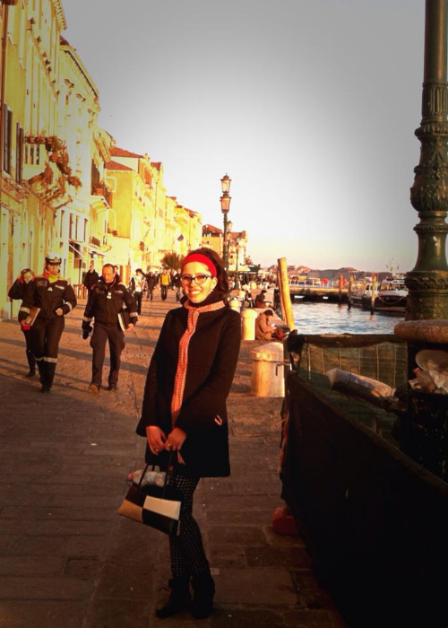 Sporting my new coat along the Venice canals.It was a clear but cool day. I frozein the dark,unheated Palazzo Ducale but the warm Venice sunshine was beautiful!