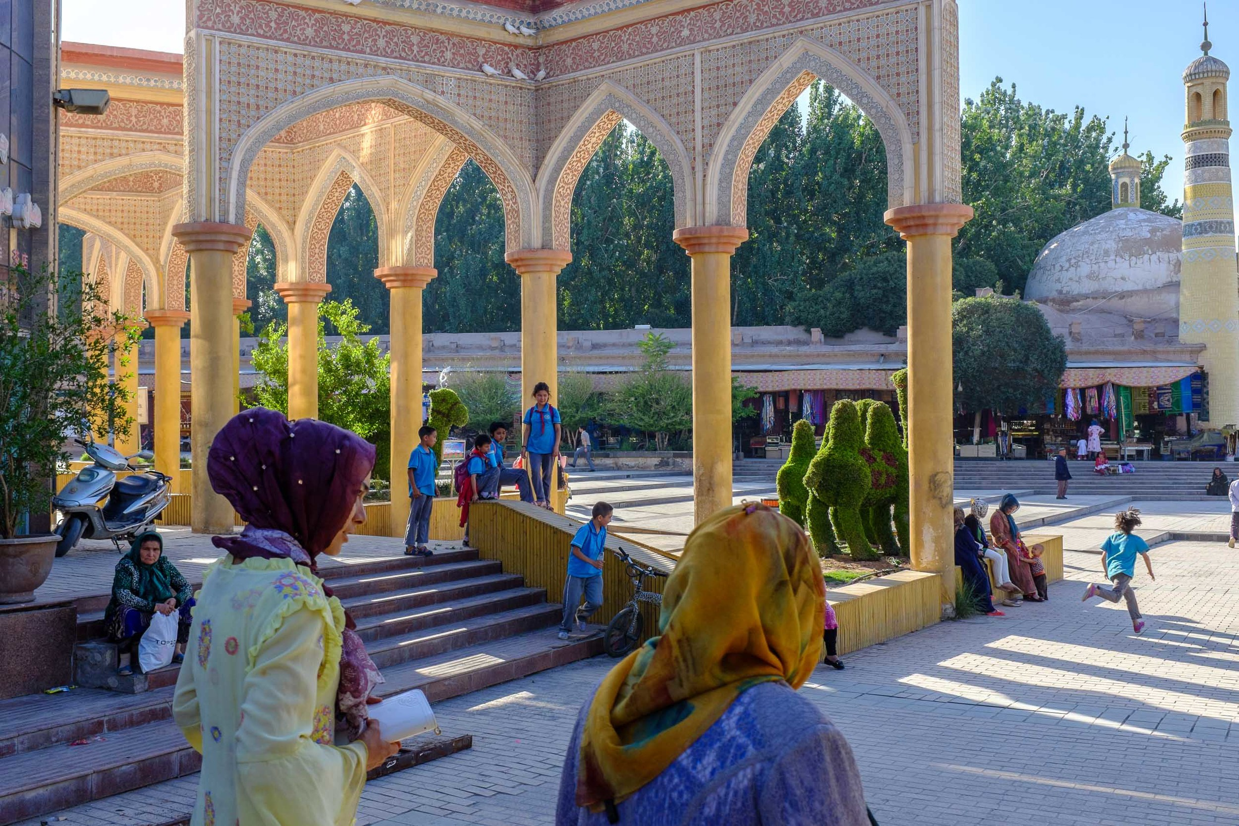 Locals gathering in the Id Kah Mosque square