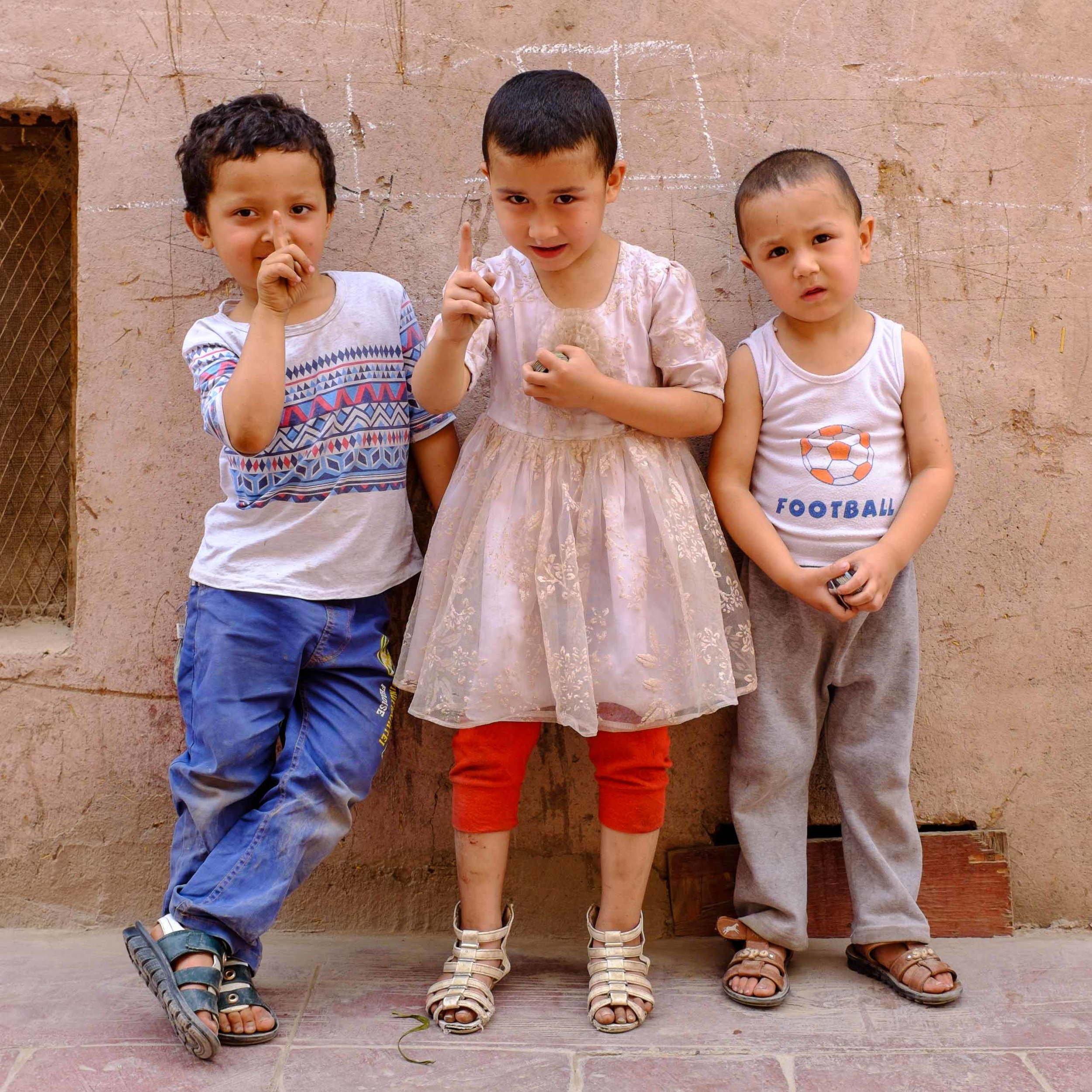These kids were playing with Pogs in the street but leapt up to pose when they saw my camera.