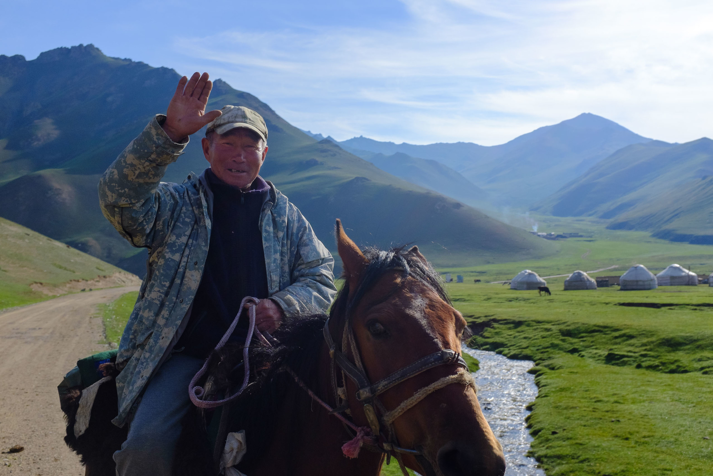 A Kyrgyz cowboy greets us on our way out of the Tash Rabat valley