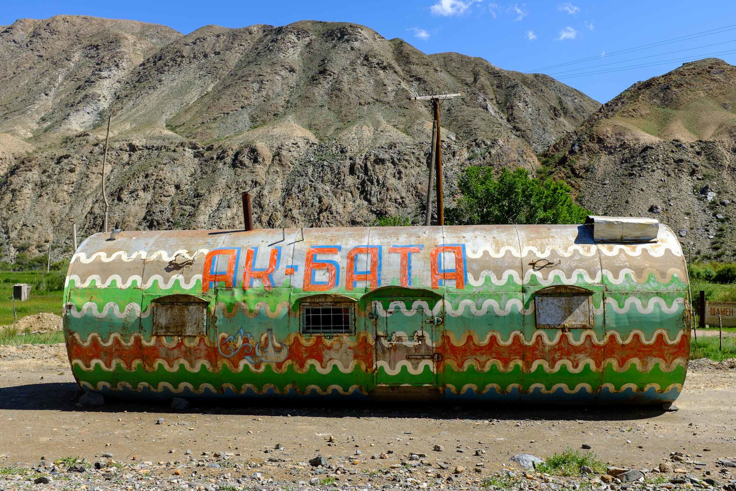 An oil tank converted to a colorful home or shop outside Sary-Bulak