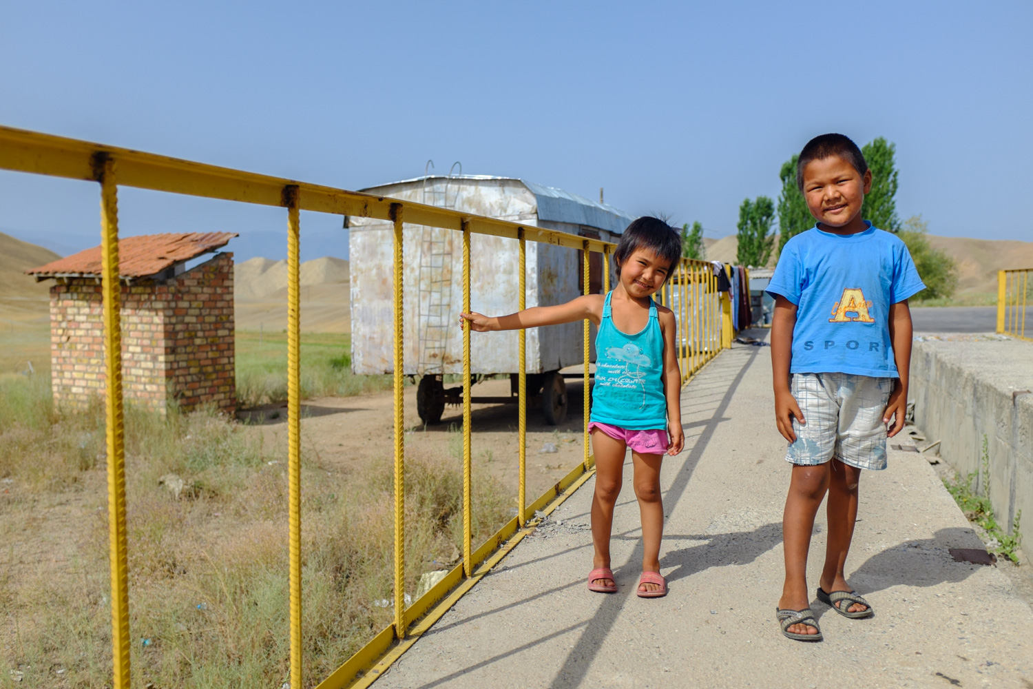 Two kids at a Kyrgyz truck stop near Toktogul lake
