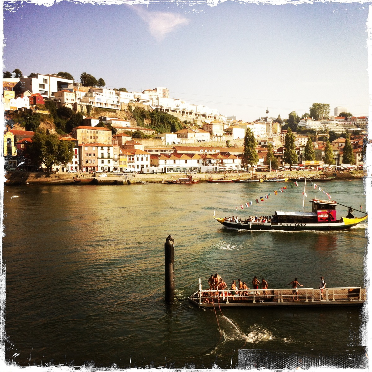 View of the River Douro in Porto, Portugal, where kids were flinging themselves off the dock on a hot summer day.