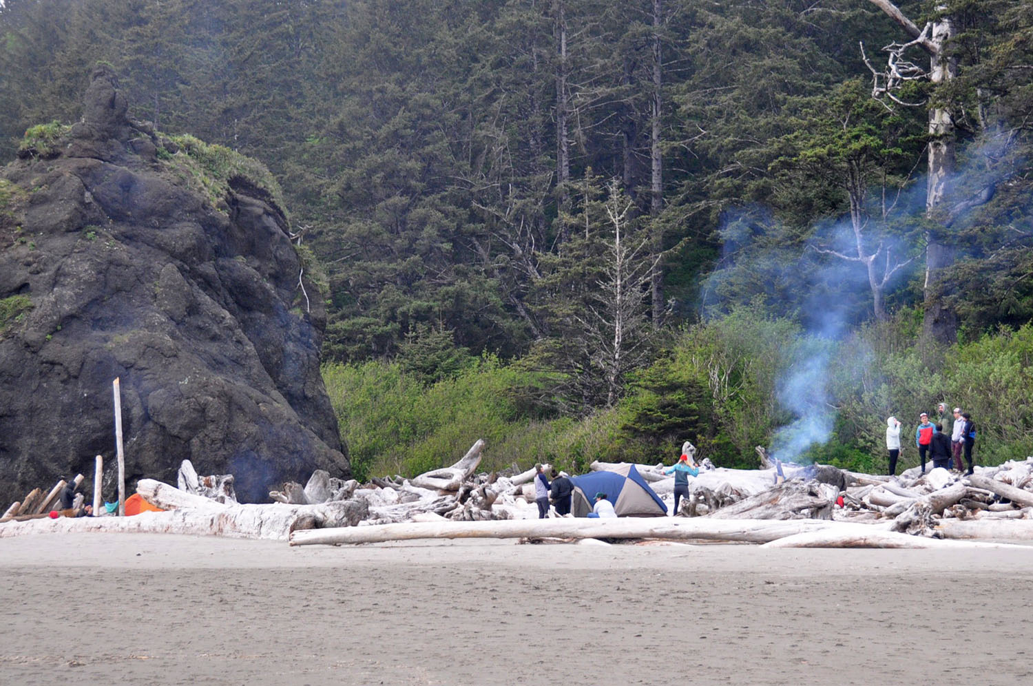 Campers congregating on Second Beach in La Push