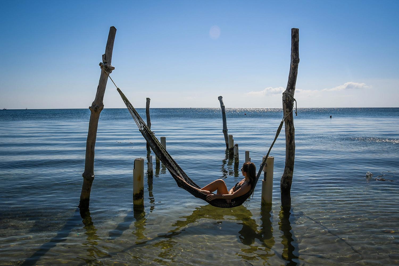 Roatan vs. Utila Honduras Bay Island Hammock over water