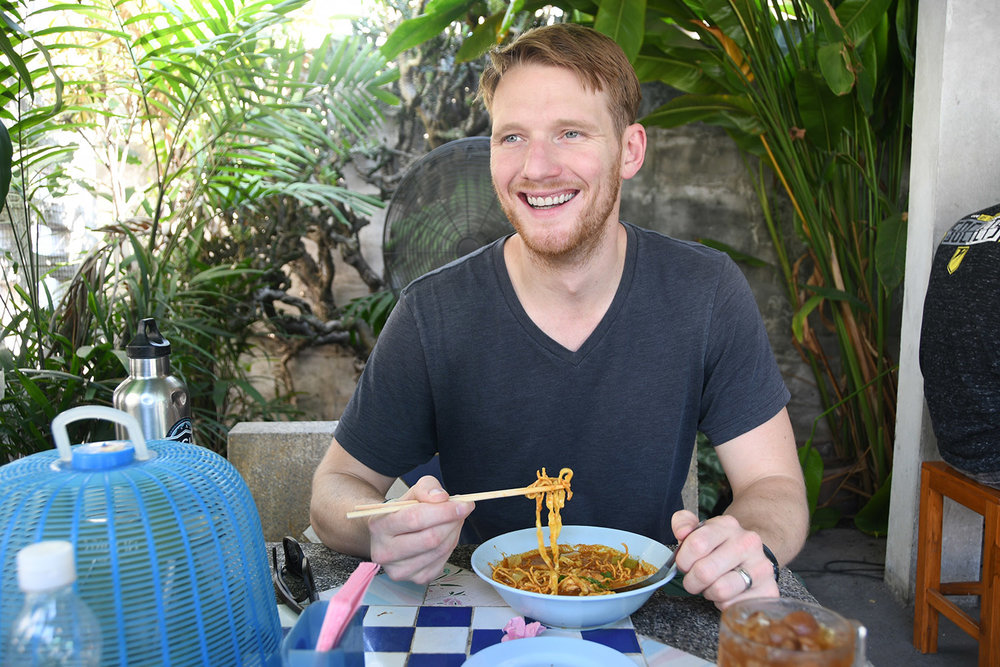 Trying the dish at the famous Khao Soi Khun Yai