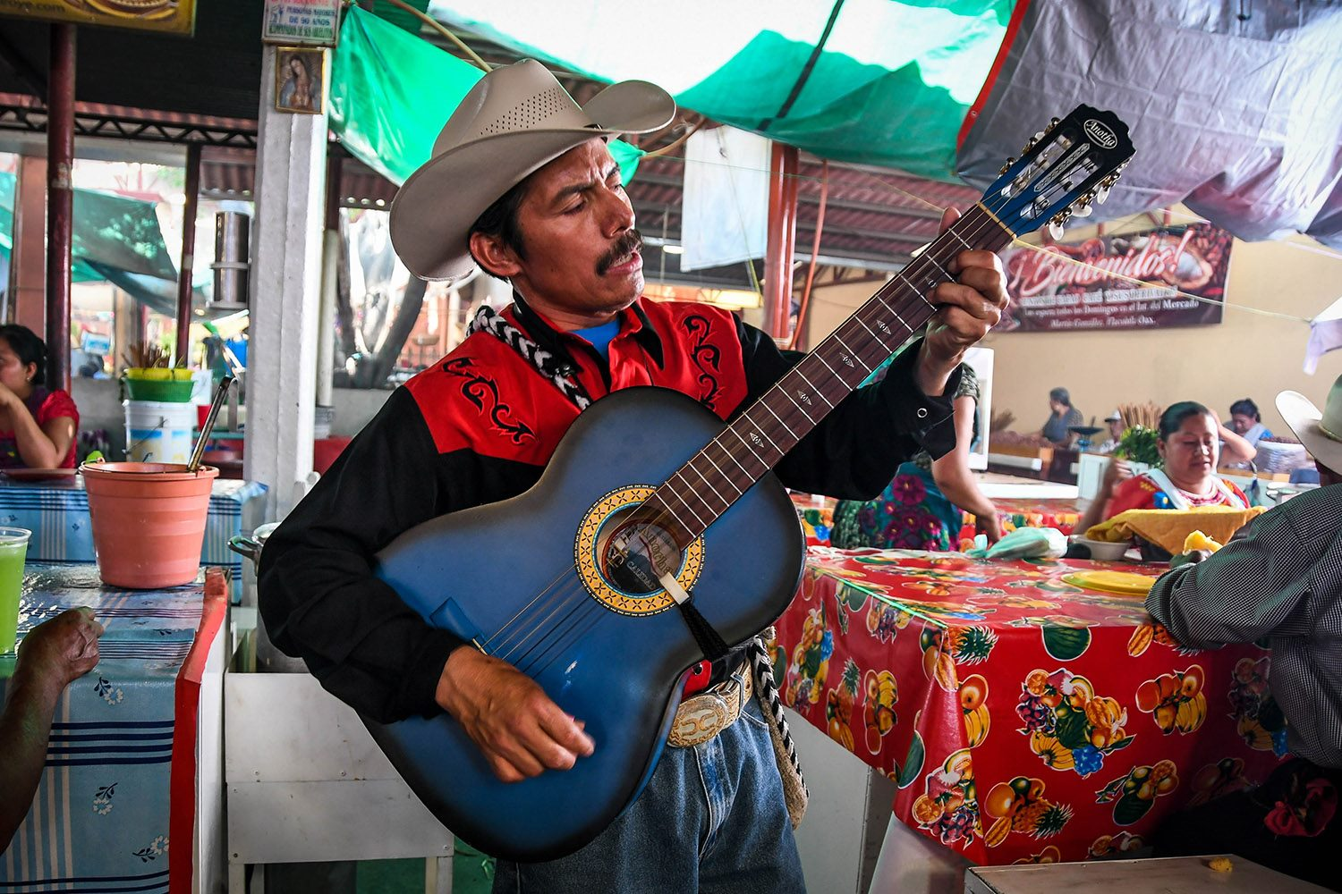 Things to Do in Oaxaca Sunday Market Tlacolula Guitar player