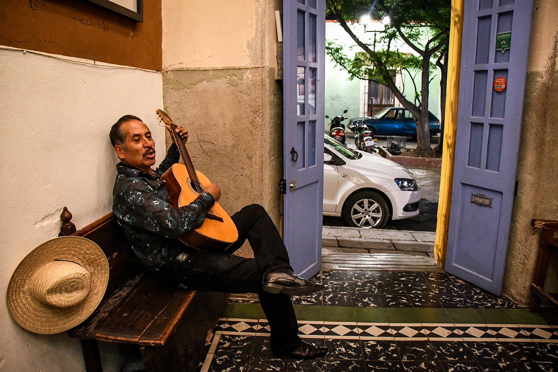 Things to Do in Oaxaca Guitar Player Mezcal