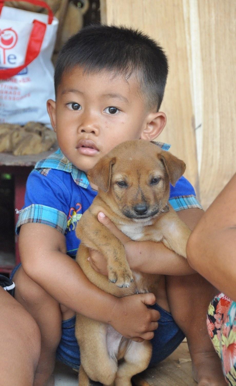 Balinese boy and dog