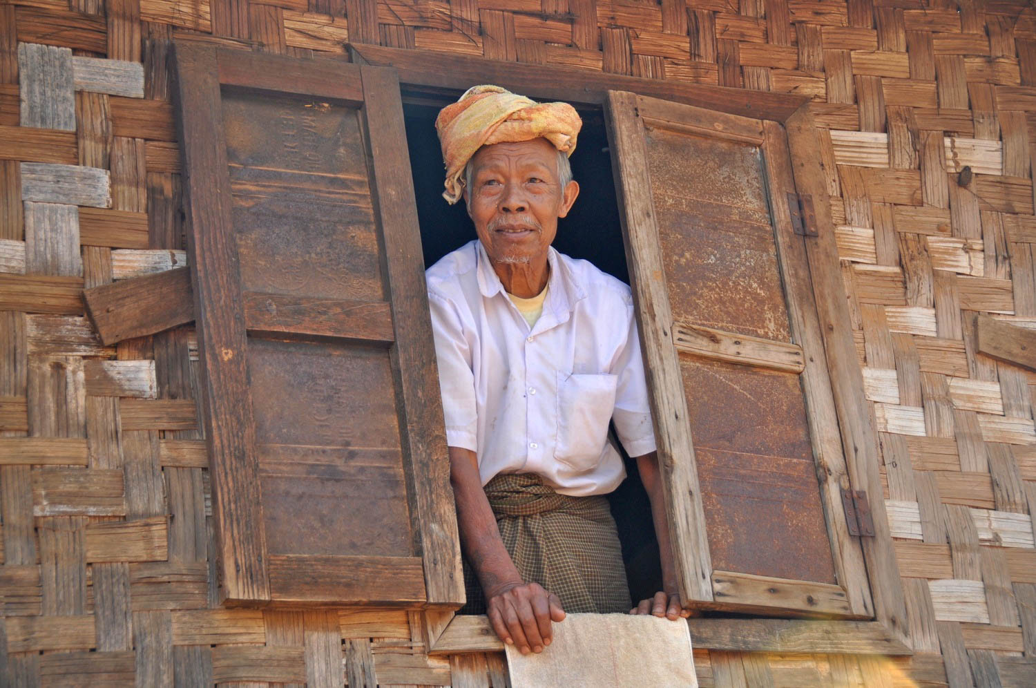 Myanmar Old Man in window