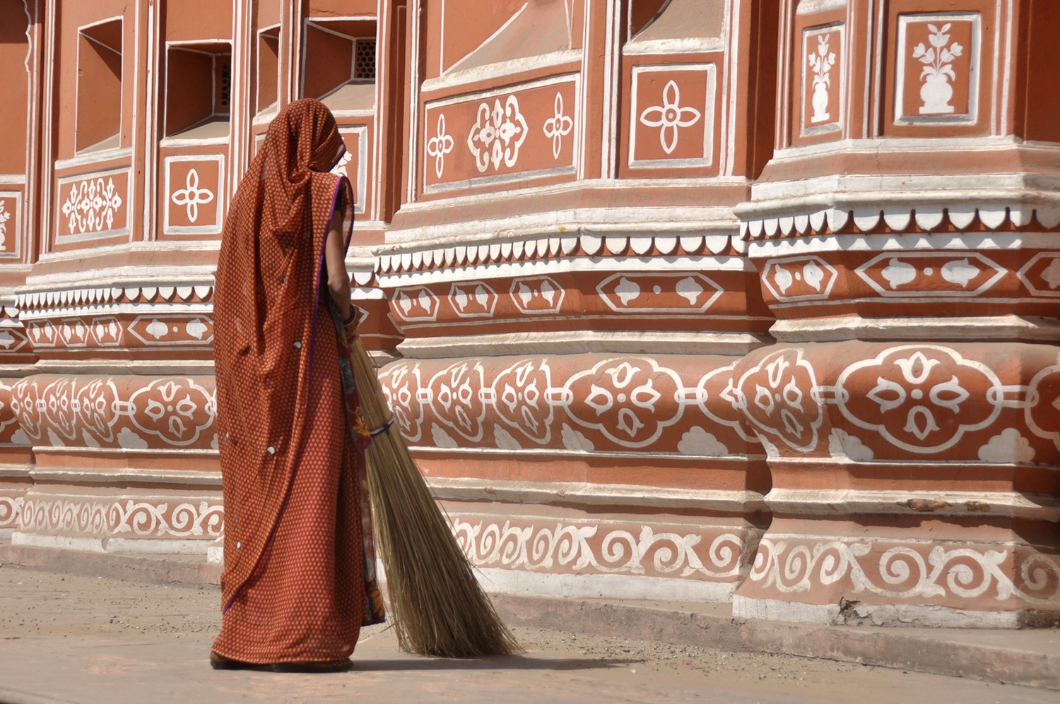Woman cleaning the streets in India
