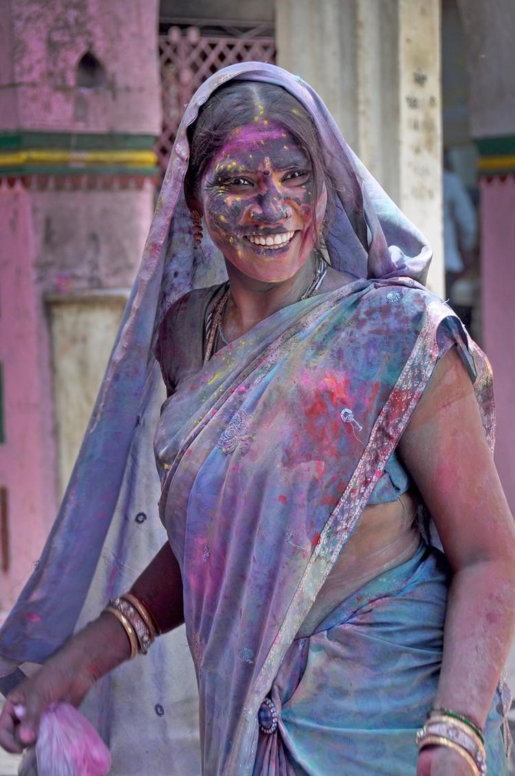 Woman celebrating Holi in India