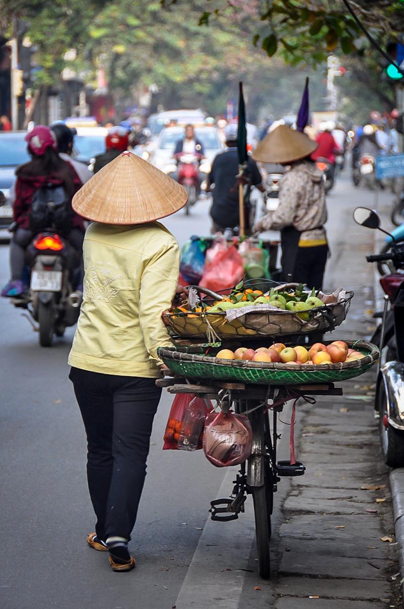 Things to Do in Hanoi | Woman selling fruit in Hanoi, Vietnam