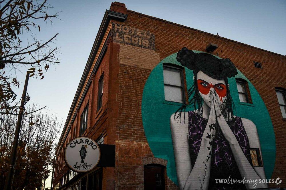Girl next to Charro del Rey Tucson Street Art